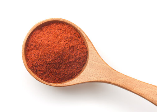 Top view of of red paprika powder in wooden spoon