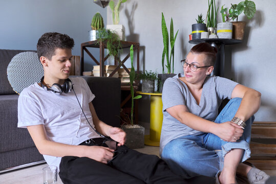 Teen boy talking to psychologist, individual therapy session for teenage with doctor