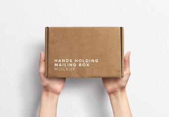 Hands Holding Postal Box Mockup