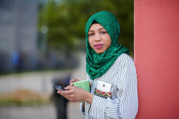 african muslim businesswoman using mobile phone