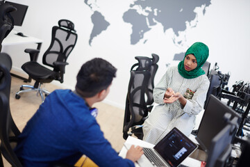 Multiethnic startup business team with Arabian woman