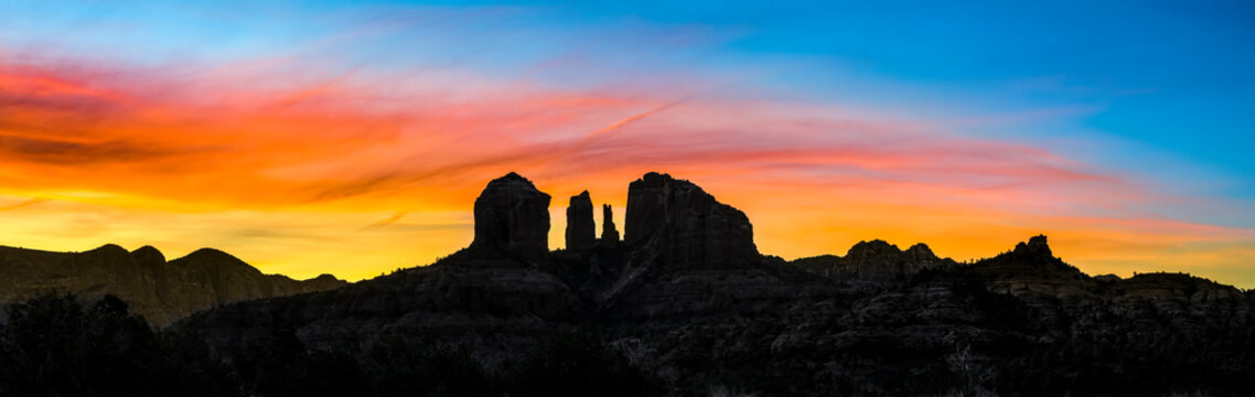 Sedona Sunrise - An iconic rock formation, Cathedr4al Rock, is silhouetted by a beautiful sunrise sky in Sedona, Arizona in the beautiful Southwest of America.