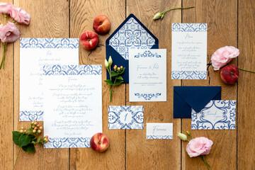 Elegant invitations near fruits and flowers