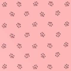 Viele Katzenspuren auf rosa Untergrund