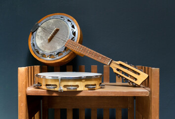 Old wooden banjo and tambourine