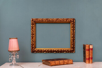 Empty gold rectangular vintage frame on a wall