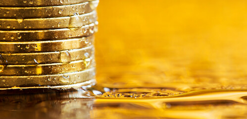 Gold investments concept, precious metal savings, stack of money coins. COVID-19 finance. Web banner.