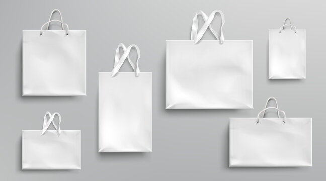 Paper shopping bags mockup, white packages with rope and lace handles, blank rectangular ecological gift packs, isolated mock up for branding and corporate identity design, Realistic 3d vector set