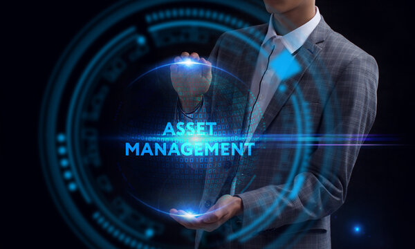 Business, Technology, Internet and network concept. Young businessman working on a virtual screen of the future and sees the inscription: Asset management