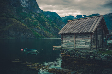 Wall Mural - Scenic Norwegian Fjord Landscape with Rustic Cabin