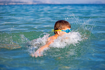 A kid swimming in the sea