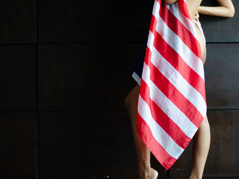 Beautiful, sexy, young brunette woman in flag ,4th july concept