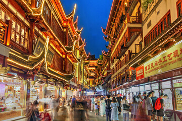 Commercial alley in Yu Yuan Gardens and Bazaar in old Shanghai, China at night