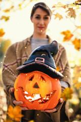 girl with halloween pumpkin