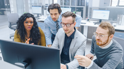 In Modern Office: Diverse Team of Young Motivated Businessmen and Businesswoman Work on Computer,...