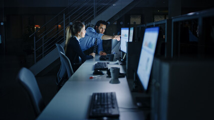 Confident Businessman Uses Desktop Computer, Her Male Manager Explains Specific Tasks, Account...