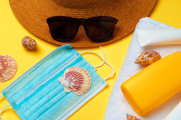 Sunscreen cream and protective mask. Coronavirus summer concept