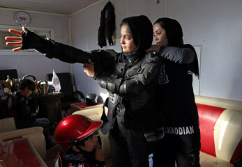 Negin Afshar, 16, one of the motocross racers, prepares herself before an exercise in Kabul
