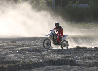 A member of a motocross team is seen during a training in Kabul
