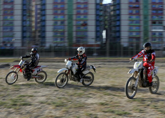 Members of a motocross team are seen during a training in Kabul