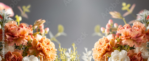 Autumn composition made of beautiful flowers on dark backdrop. Floristic decoration. Natural floral background.