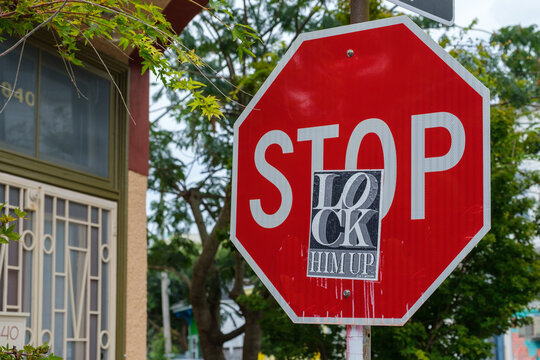 Stop sign with Lock Him Up sticker