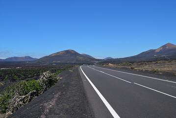 Tar road between volcanic landscape. Lanzarote. Spain
