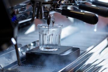 professional coffee machine makes espresso