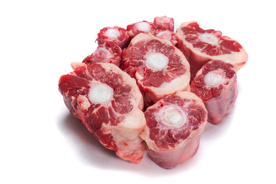 Fresh uncooked ox tail portions on white background. Meat industry product.