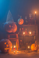 Halloween decoration with pumpkins and magic potions indoor