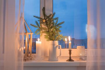 Christmas evening windowsill with burning candles