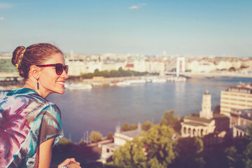Happy young woman wondering in city panorama Budapest, Hungary