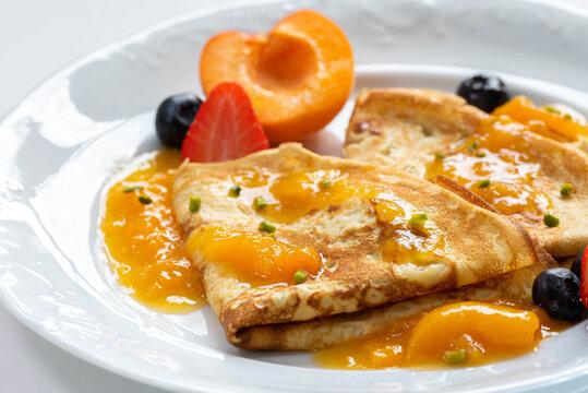 fresh homemade Pancakes with fruits and Jam. Marmeladepfannkuchen mit frischen Früchten