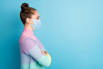 Profile side view portrait of her she attractive healthy girl wearing gauze mask folded arms...