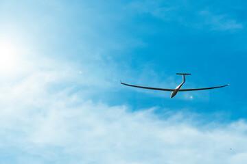 Glider plane flying at sunset