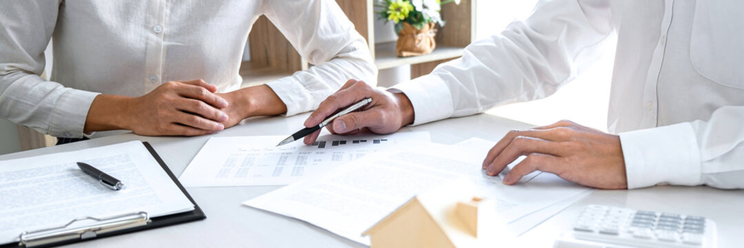 Estate broker agent presenting and consult to customer decision making sign insurance form agreement
