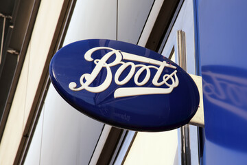 London, UK, February 27, 2011 : Boots chemist logo advertising sign outside it's retail pharmacy store in London city centre