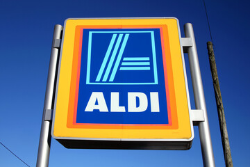 Carmarthen, Wales, UK – January 2, 2017:  Aldi logo advertising sign outside its retail supermarket stores in the city centre