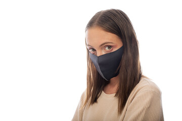 Beautiful woman wearing black face mask because of air, white background, copy space