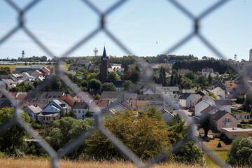 The village of Spangdahlem and radar towers of the U.S. Spangdahlem Air Base are seen through a fence in the Eifel region near Bitburg
