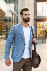 Attractive young bearded man walking outdoors