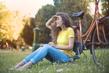 portrait of girl in park with bicycle