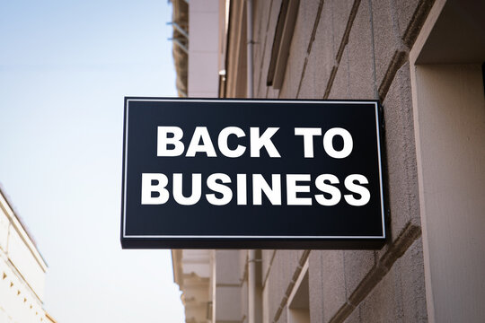 BACK TO BUSINESS. Sales, service and tourism industry concept. Black advertising sign
