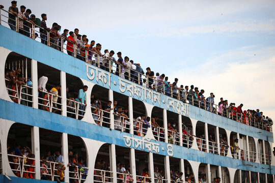 Migrant people are seen on board of an overcrowded ferry at the Sadarghat Ferry Port while leaving Dhaka to go home to celebrate Eid al-Adha, amid the coronavirus disease (COVID-19) outbreak, in Dhaka