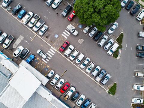 Car park beside shopping center in town