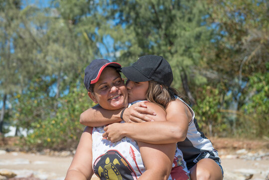 Indigenous mother and daughter hugging