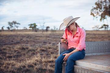 Female farmer holding iPhone