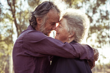 Happy elderly couple kiss in the Northern Territory