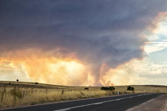 Country road with sun shining through billowing smoke