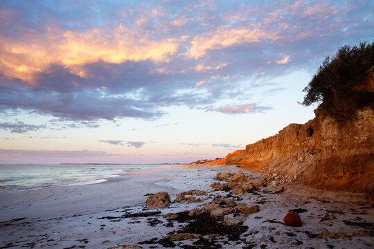 small cliffs along beach at sunrise